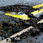 pothole on road needs accrediting