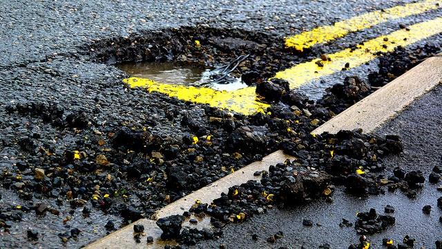 pothole on road needs accrediting
